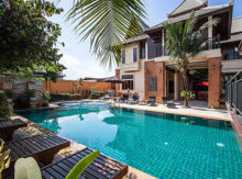 What are the benefits of living in a house in Pattaya as opposed to a condo