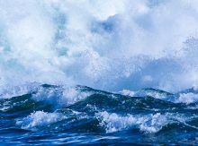 The impact of serial Covid waves globally